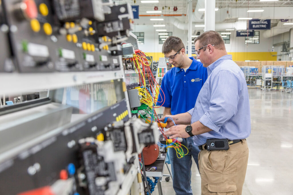 Instructor with student teaching engineering & electronics technology programs