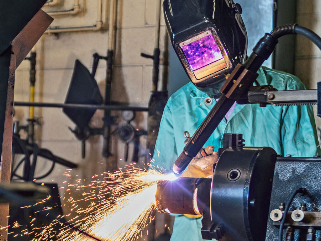 Student in class welding